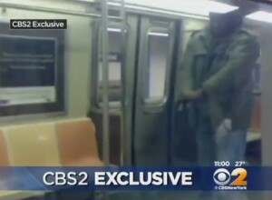 [VIDEO] Older Story, New To Us: Man Holds Bad Guy At Gunpoint After He Was Assaulting Woman On NYC Subway